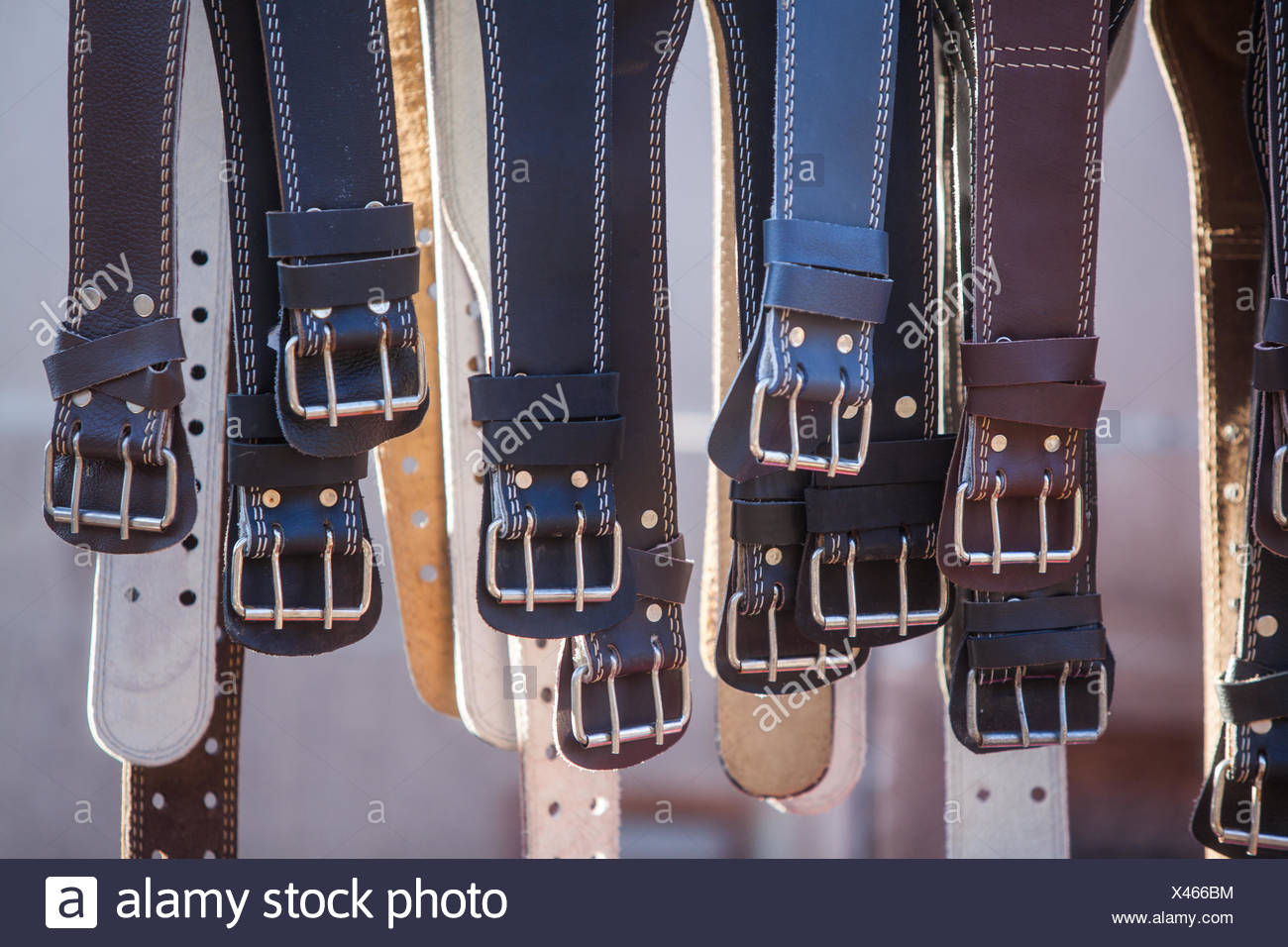 Many leather belts - Stock Image