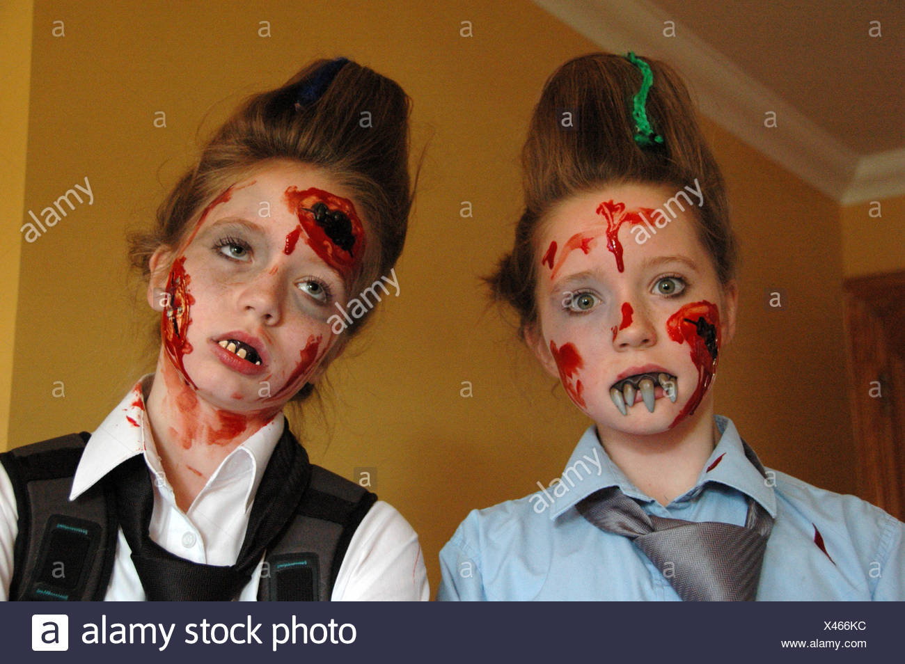 Two Teenage Girls With Painted Faces - Stock Image