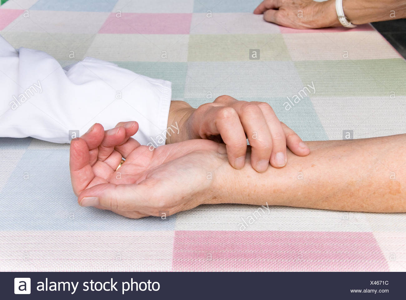 pulse senior patient - Stock Image