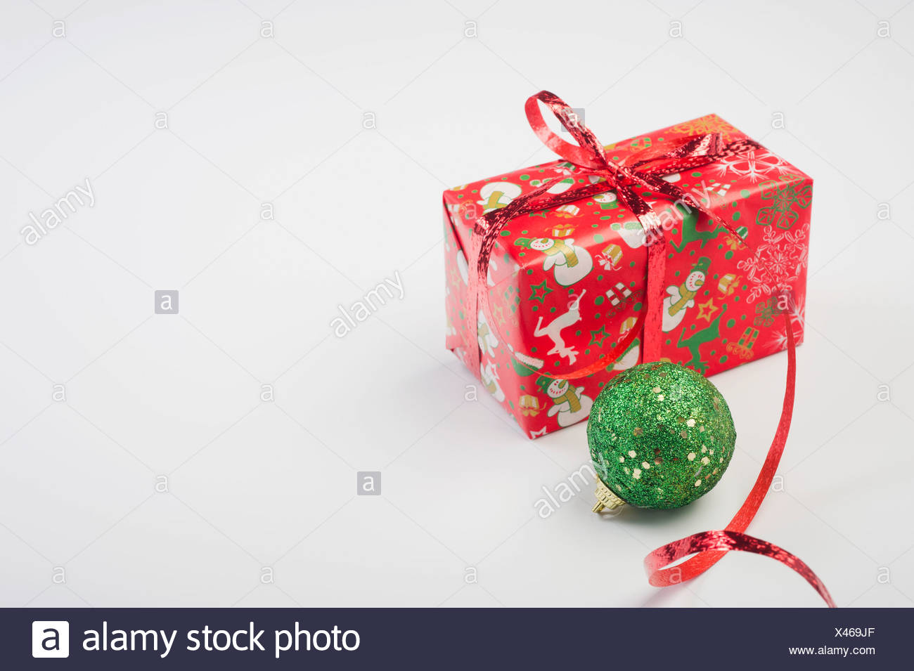 Christmas ornament and festively wrapped present - Stock Image