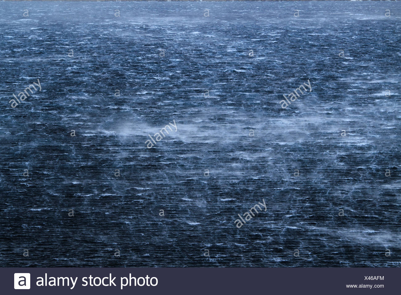 Raging sea with furious waves and fierce wind - Stock Image