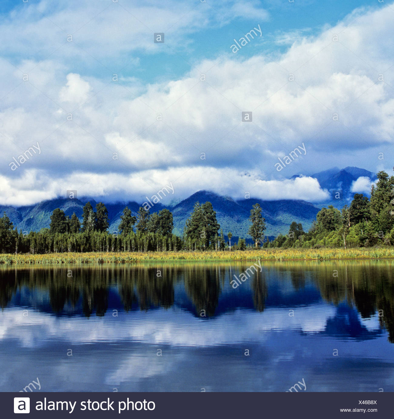 Matheson Lake with reflection on surface, Southern Alps, South Island, New Zealand - Stock Image