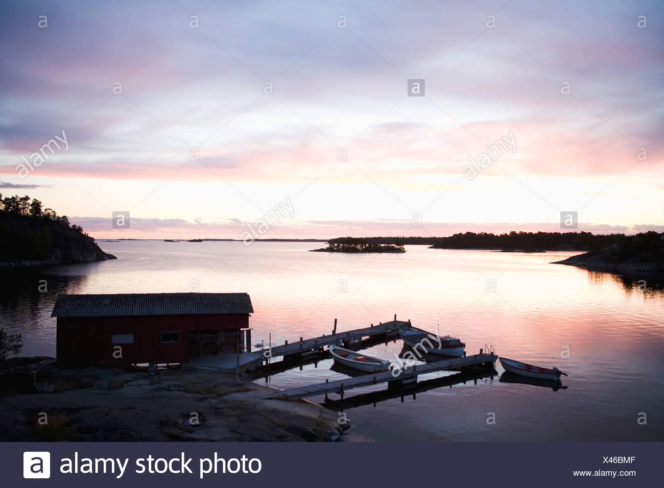 A boathouse in the sunset in the archipelago of Stockholm Sweden. - Stock Image
