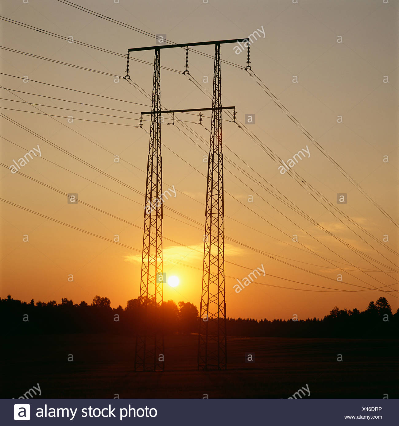 View of electricity pylon at dusk - Stock Image