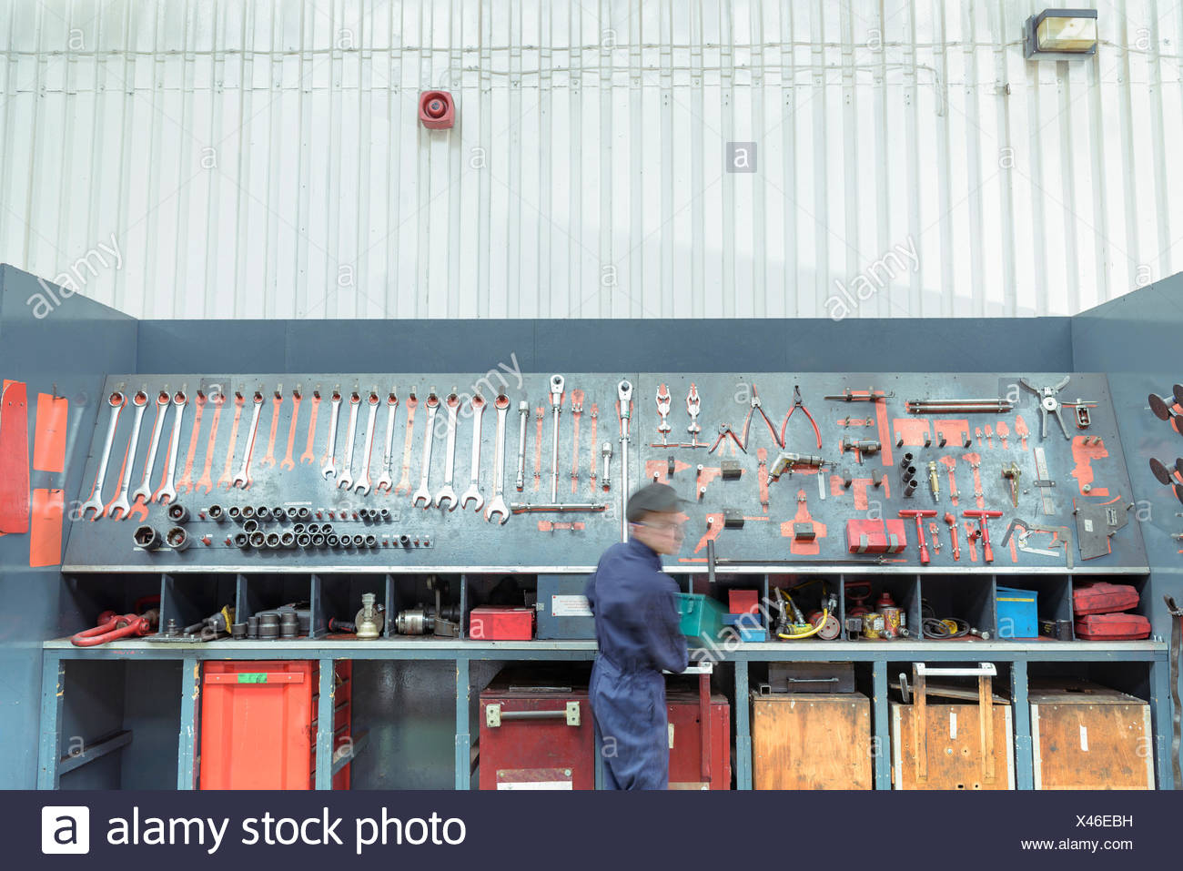 Locomotive engineer picking tools in train works - Stock Image