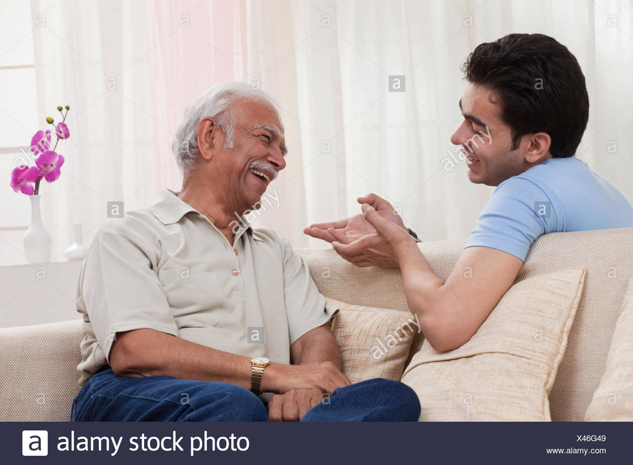 Grandson and grandfather talking - Stock Image