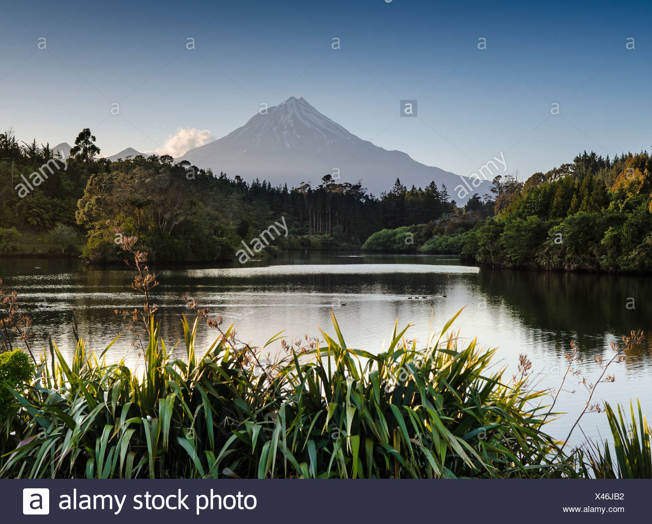 Currently inactive volcano, Mt Egmont, Mt Taranaki, Lake Mangamahoe reservoir, dam, North Island, New Zealand - Stock Image