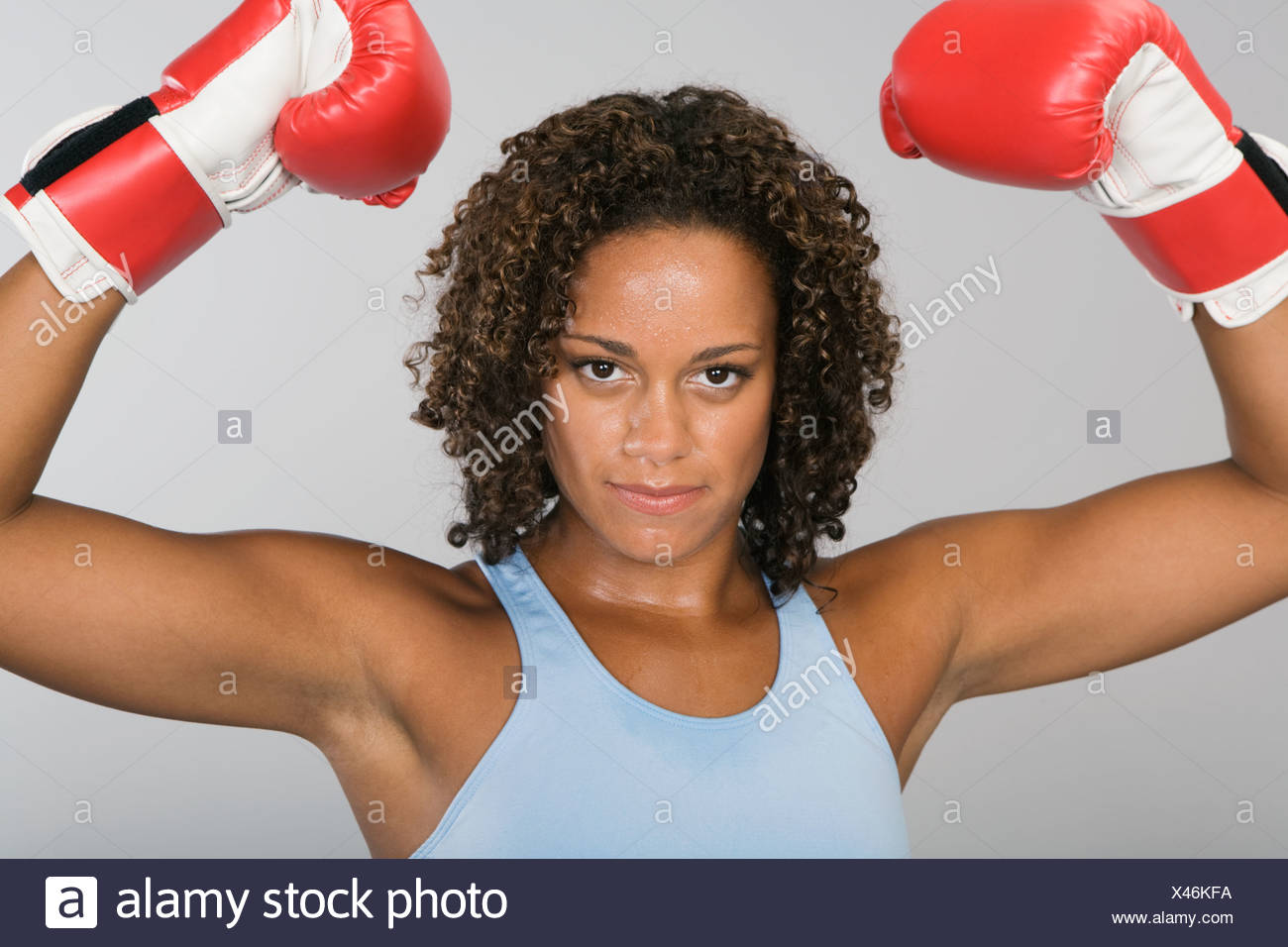African woman wearing boxing gloves Stock Photo