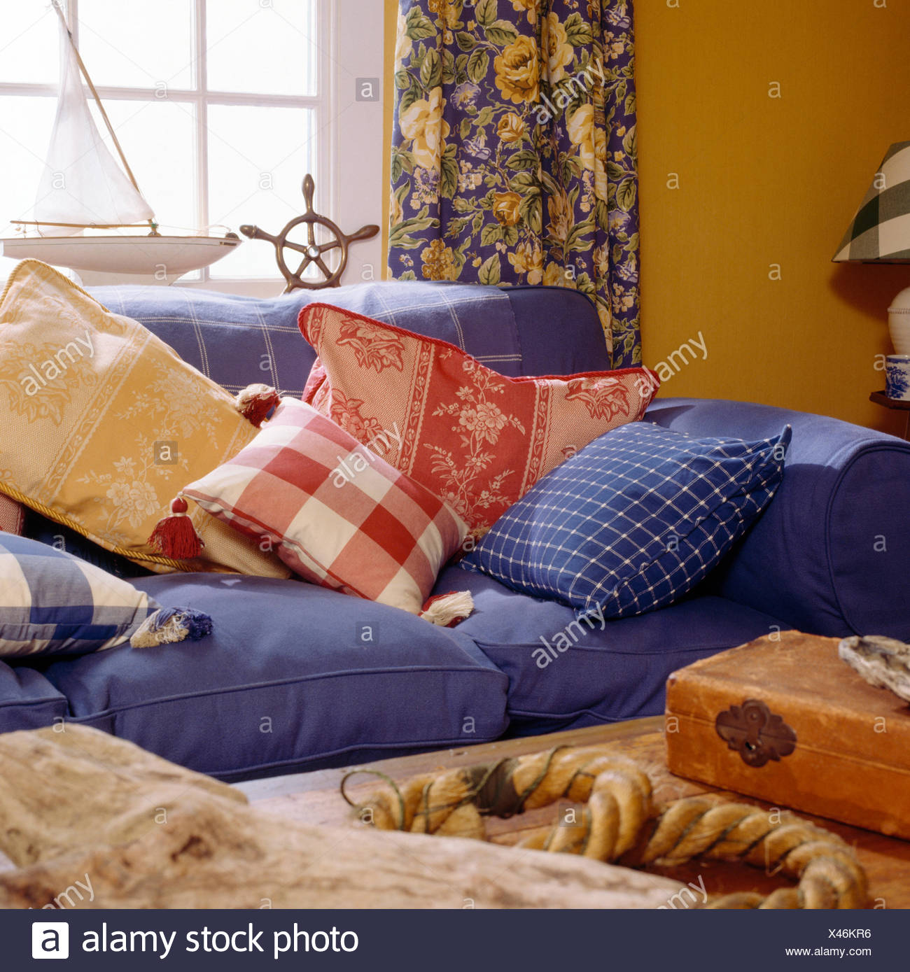 Groovy Red Checked And Floral Cushions On Blue Sofa In Cottage Interior Design Ideas Oxytryabchikinfo