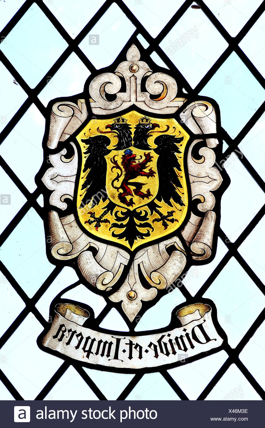 Divide et Impera, Divide and Rule, heraldic, heraldry, motto, stained glass, East Barsham Manor, Norfolk , England, UK - Stock Image