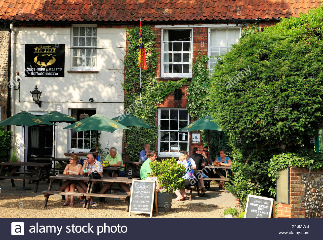 Walsingham, The Bull Inn, garden and pub, people eating drinking, Norfolk, England UK, English pubs inns - Stock Image