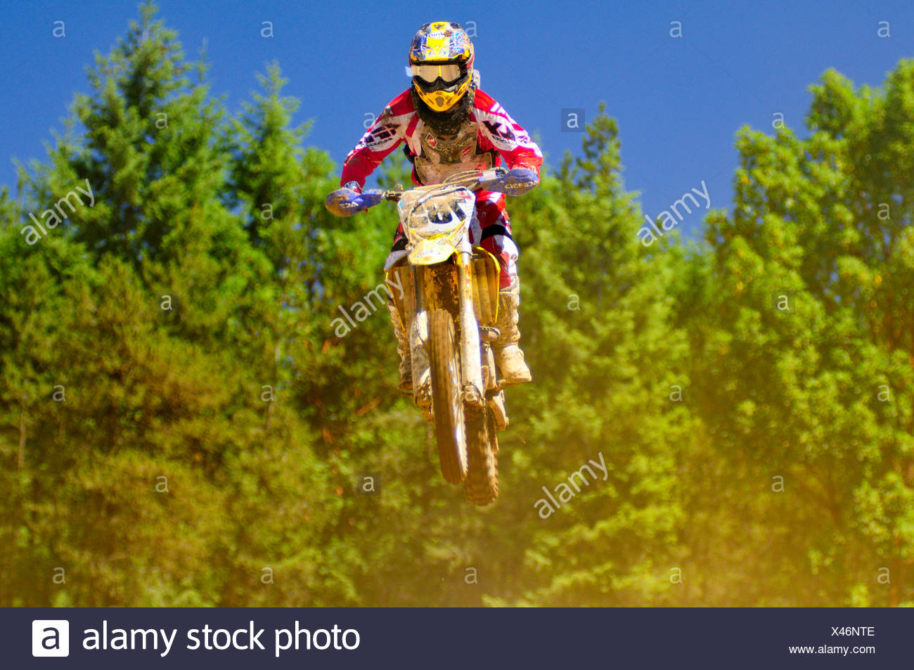 motocross racer at a jump during motocross action at the Wastelands in Nanaimo, BC. - Stock Image