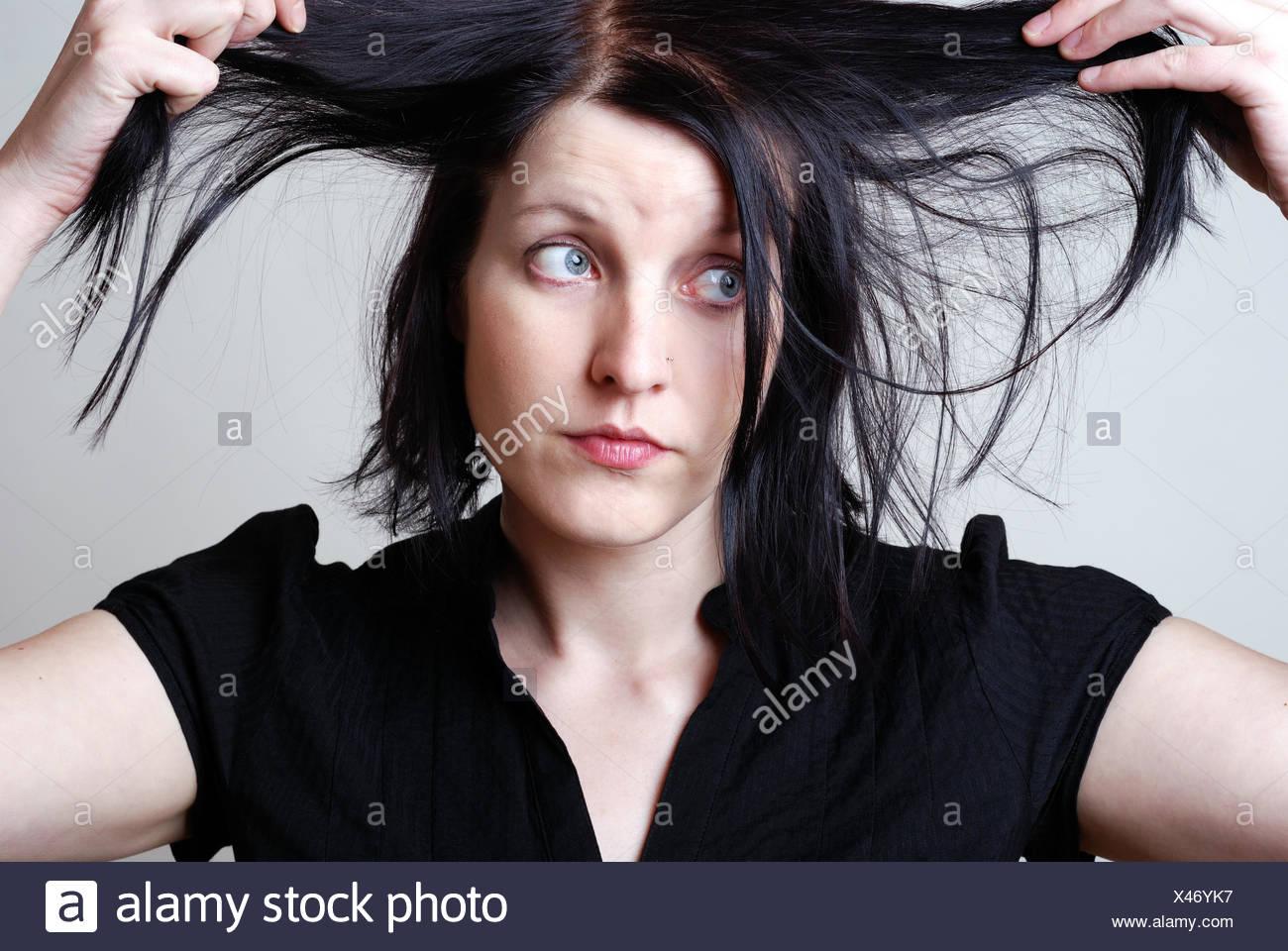 woman sad hairdo - Stock Image