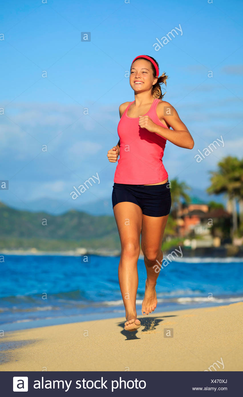 Hawaii, Oahu, Lanikai, Young Woman Running On Beach. - Stock Image
