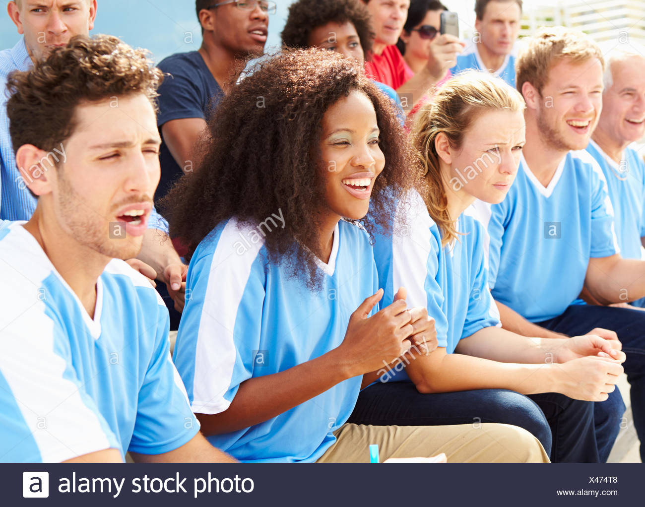 Spectators In Team Colors Watching Sports Event - Stock Image