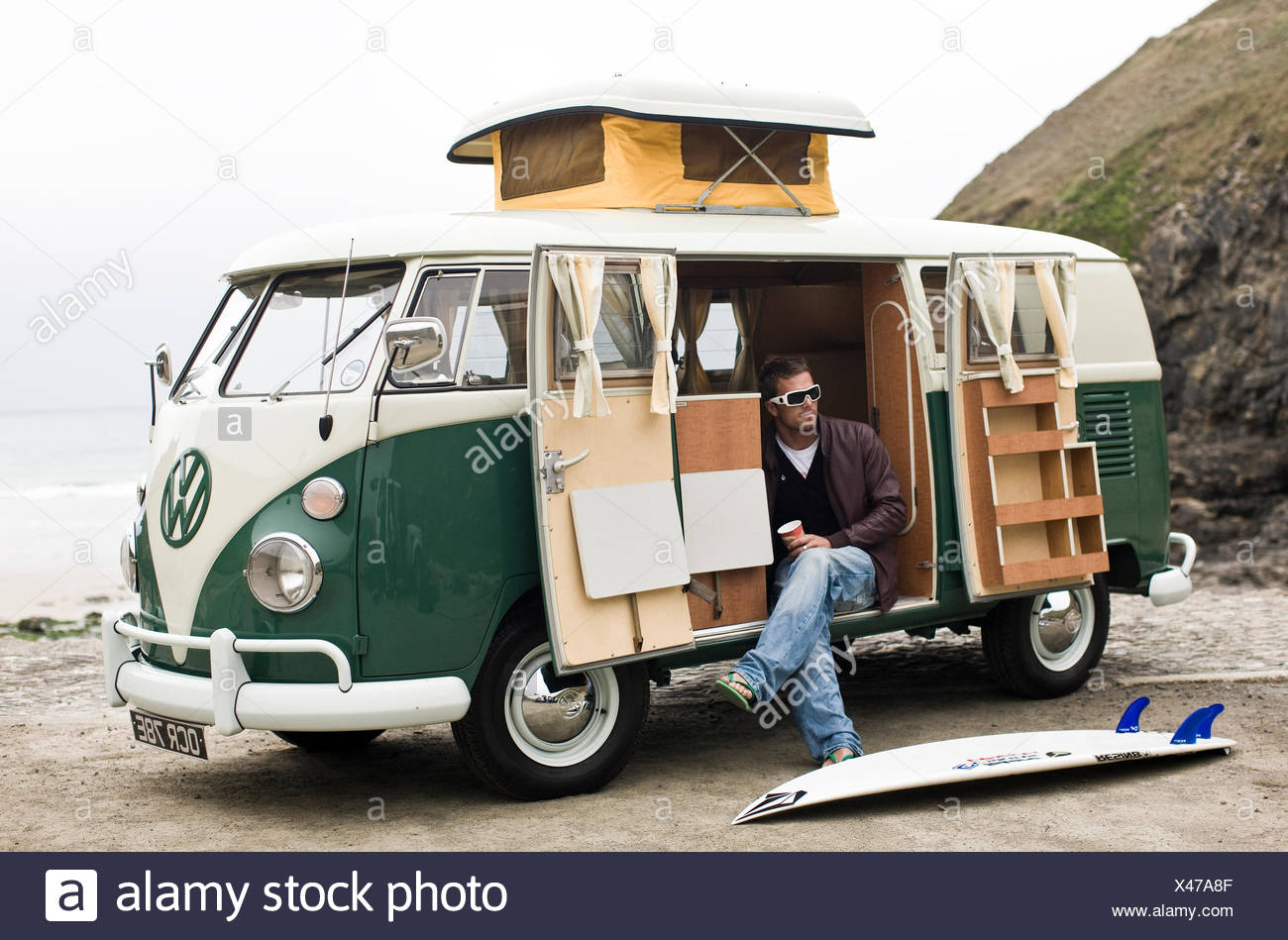 Surfers with VW campervan, St Agnes, Cornwall, UK - Stock Image