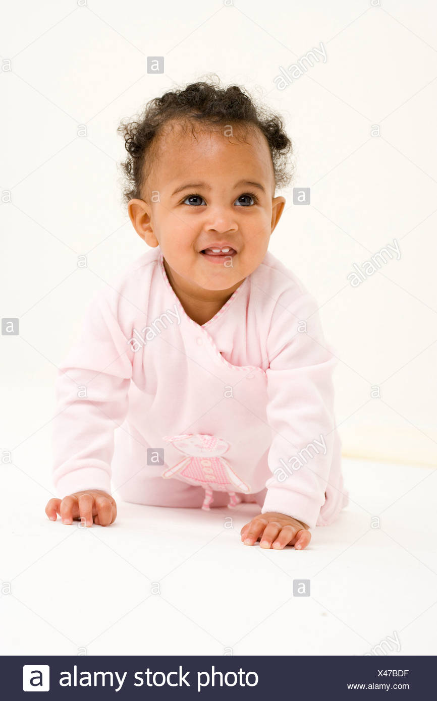 Baby girl 3-6 months smiling, portrait - Stock Image