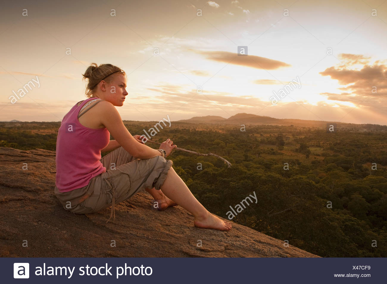 A Young Woman Looking Over The African Landscape; Manica, Mozambique, Africa Stock Photo