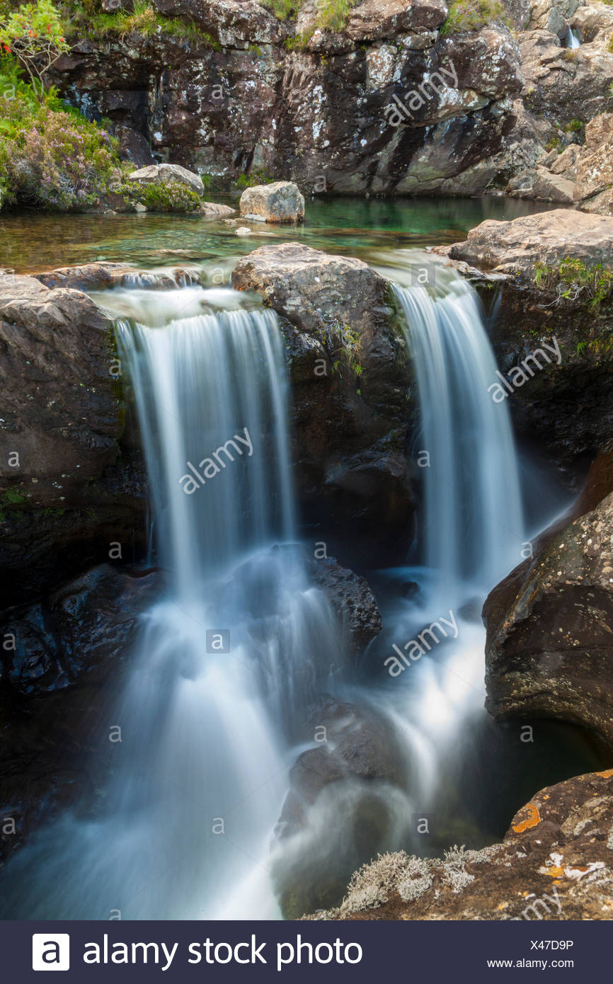 One of the rivers that from the Black Cuillins mountains flows down is characterized by the many waterfalls and deep blue pools, the fairy pools. Isle of Skye, Scotland - Stock Image