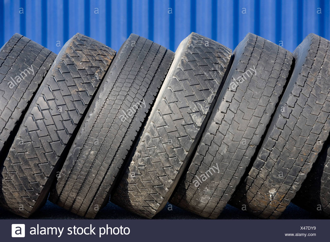 Worn-down truck tyres - Stock Image