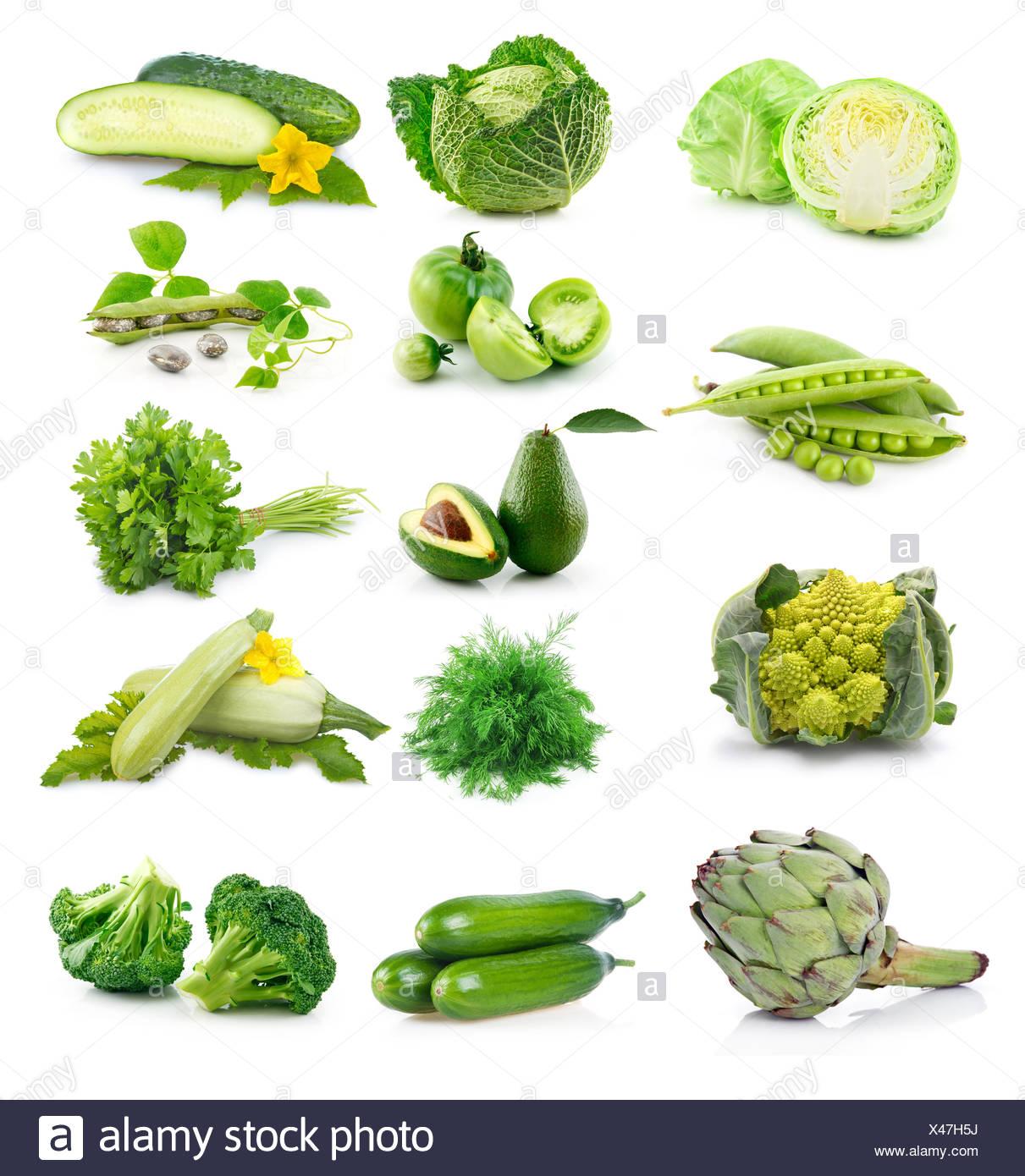 Set of fresh green vegetables isolated on white - Stock Image
