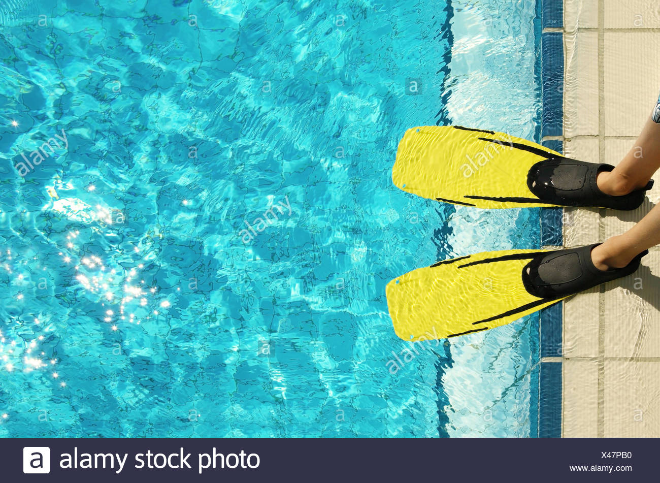 swimming pool,pool edge,fins - Stock Image