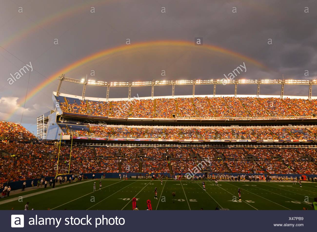 A rainbow over the stadium, Denver Broncos vs. Pittsburgh Steelers NFL football game, Invesco Field at Mile High (stadium), Stock Photo
