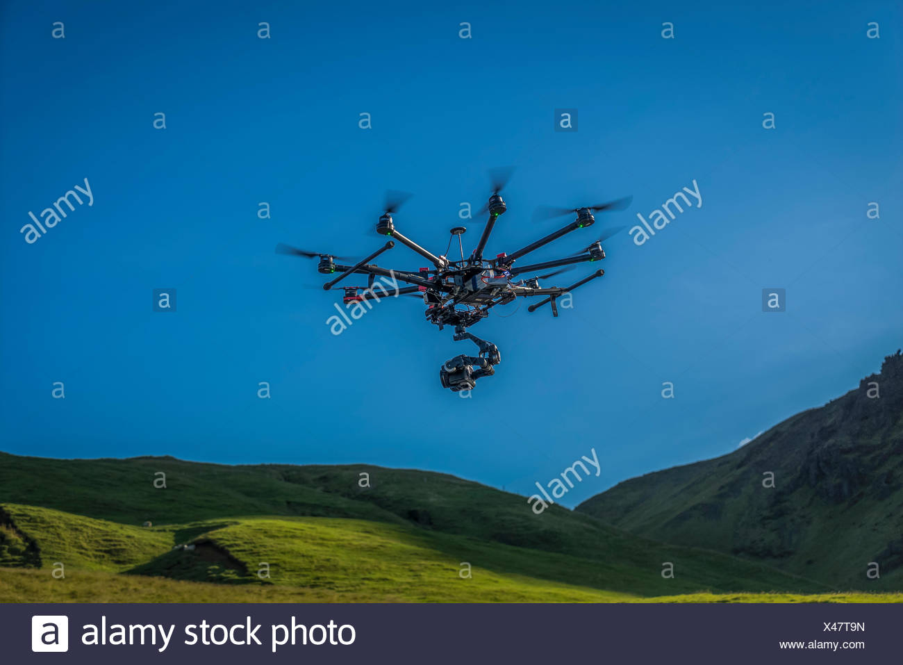 DJI S1000, Radio Controlled Drone flying with a camera by Skogafoss Waterfalls, Iceland - Stock Image