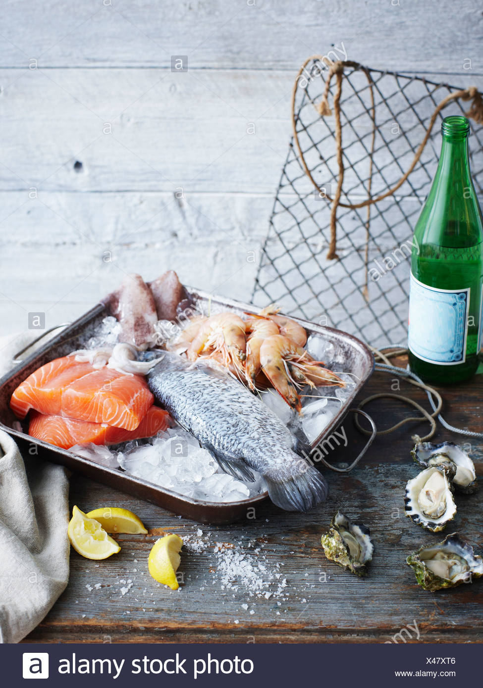 Tray of ice with fish and prawns - Stock Image
