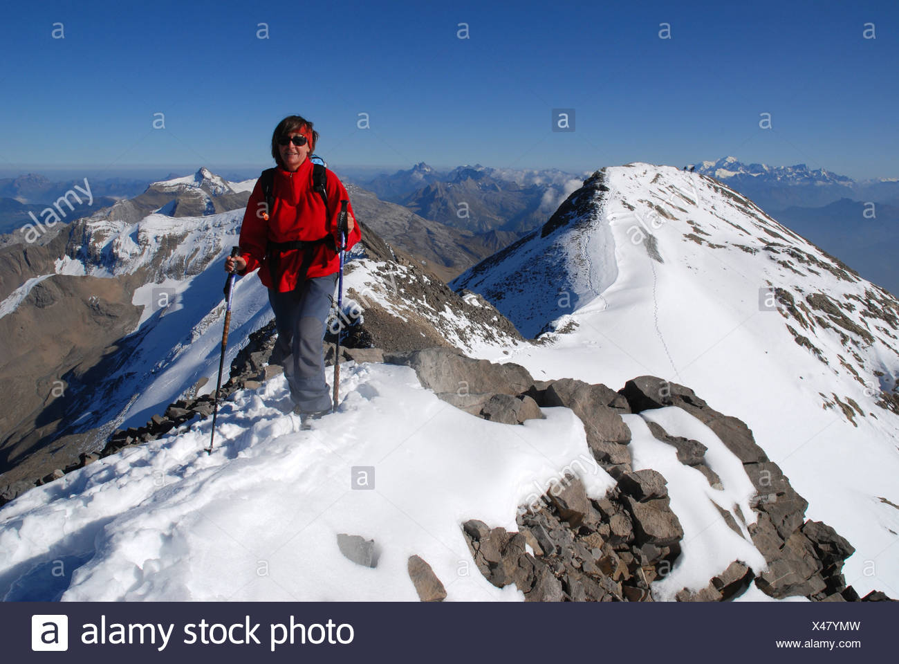 Alps, alpine, alpinisme, mountains, Bernese Oberland, mountain sport, mountaineering, woman, Wildhorn, summit, peak, Valais, Swi Stock Photo