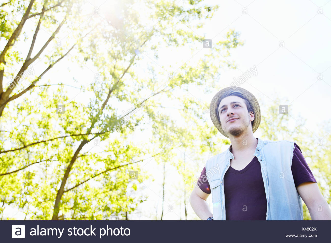 Young man wearing straw hat, low angle Stock Photo