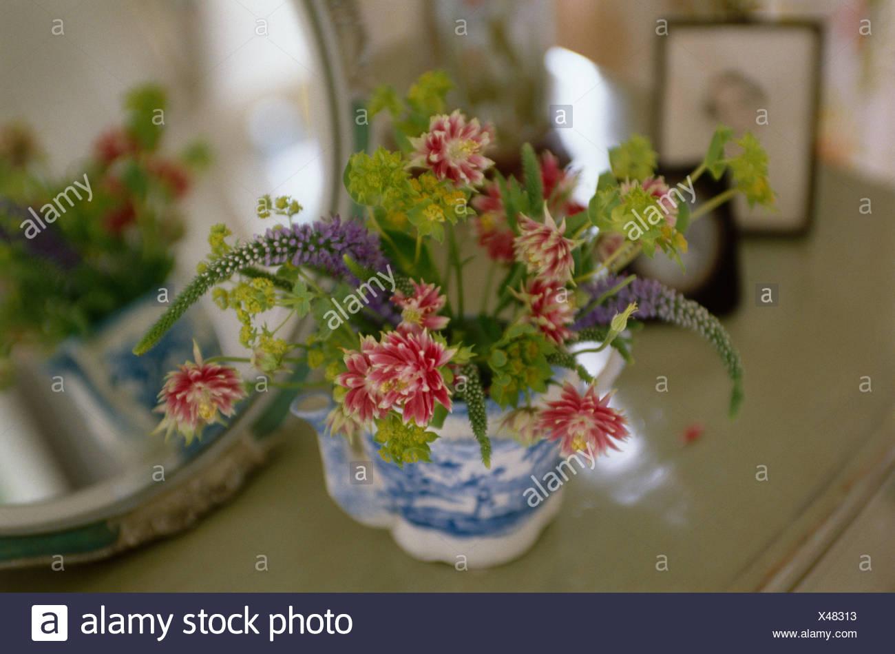 Still Life Of Summer Flowers In Bluewhite Antique Teapot Stock