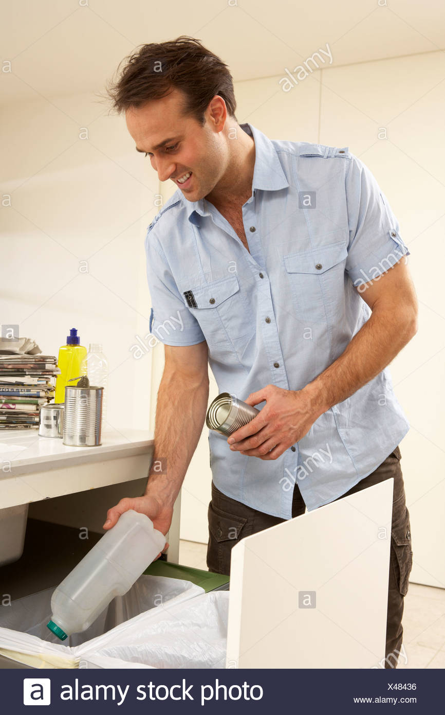 Man Recyling Waste At Home - Stock Image