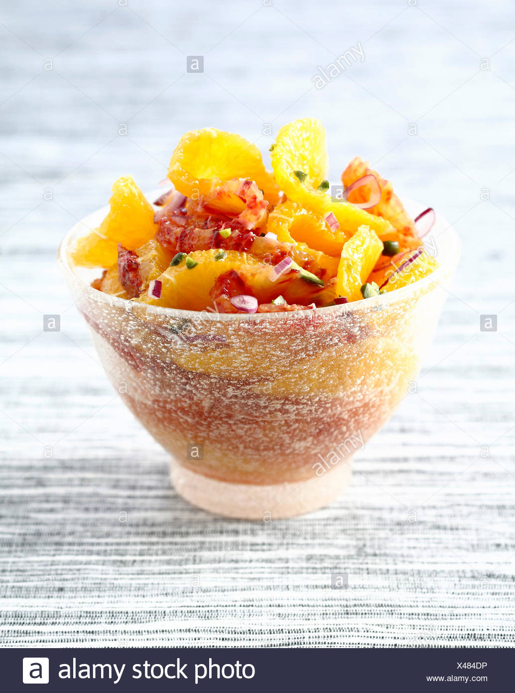 Orange fruit salad with mild onions,pistachios and argan oil - Stock Image