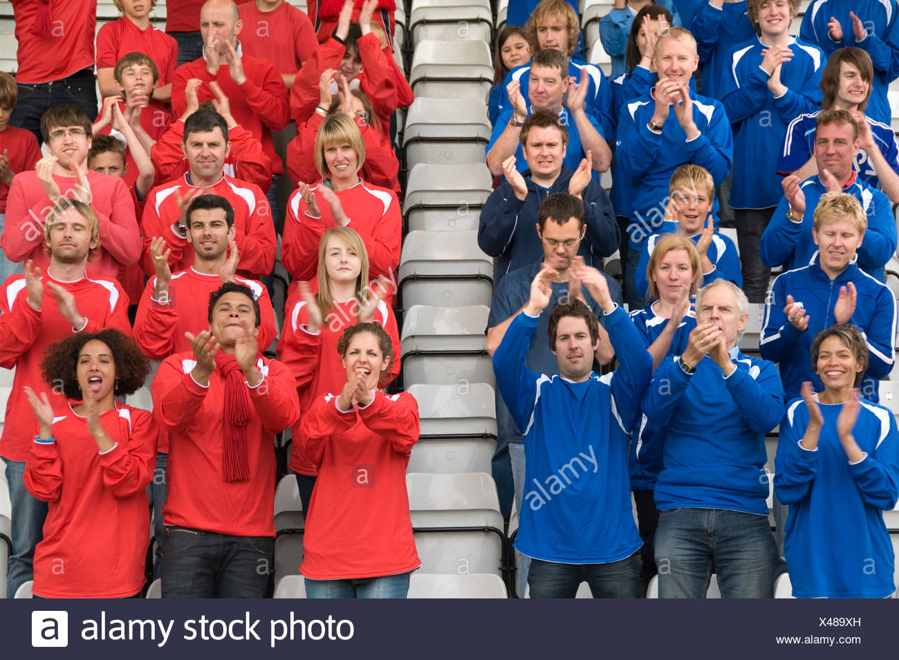 Rival fans at football match - Stock Image