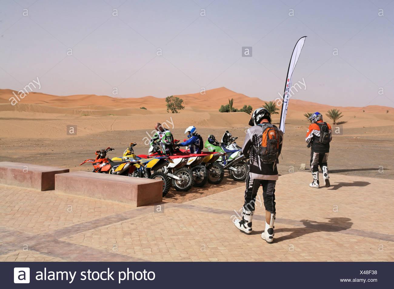 motor sport moto cross Enduro adventure Motrrad motorcycles motorbikes desert Sahara Merzouga Morocco Africa - Stock Image