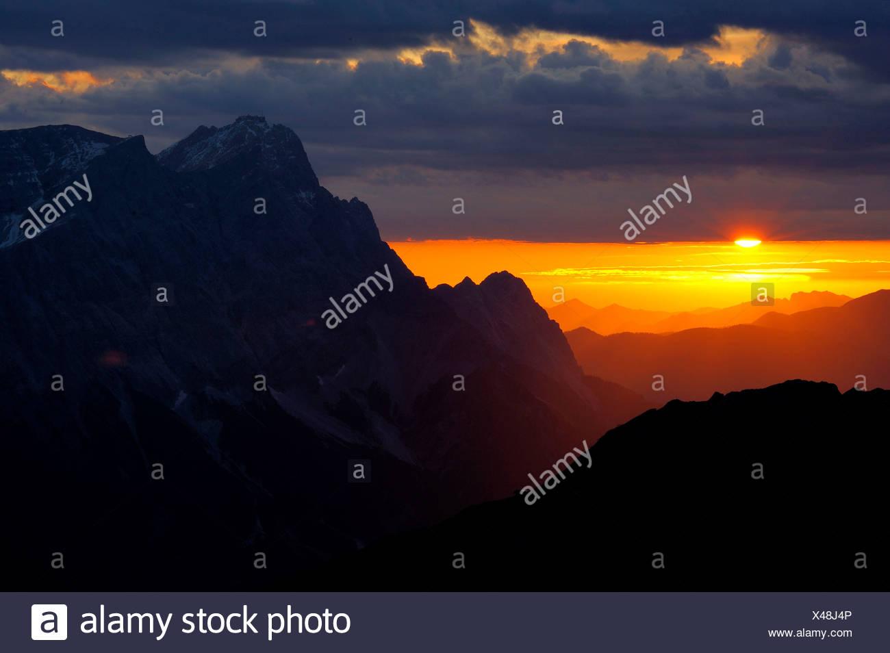 Sunrise behind Zugspitze Mountain with staggered mountain peaks, Berwang, Ausserfern, Tyrol, Austria, Europe - Stock Image
