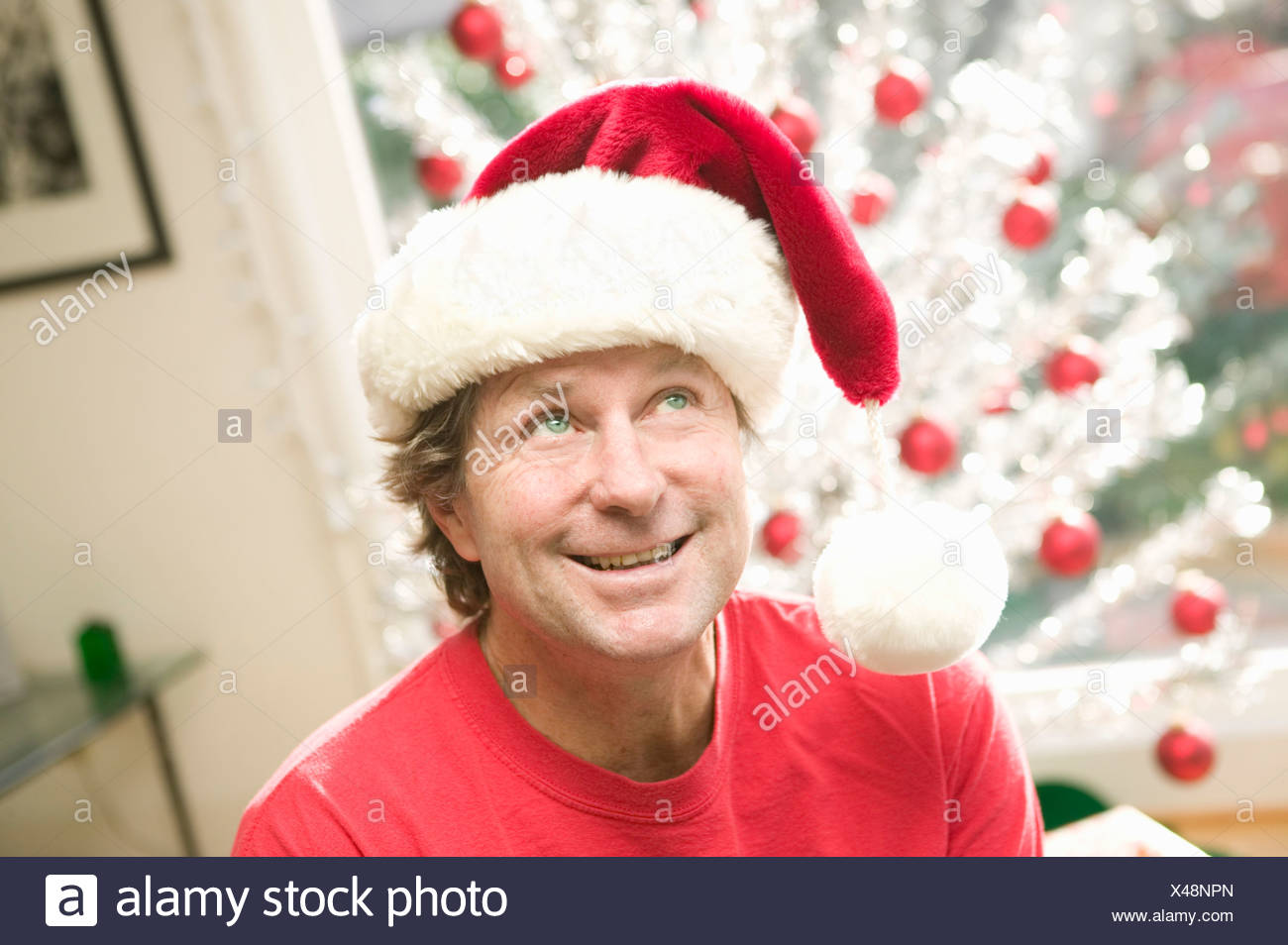 Portrait of playful man at Christmastime - Stock Image