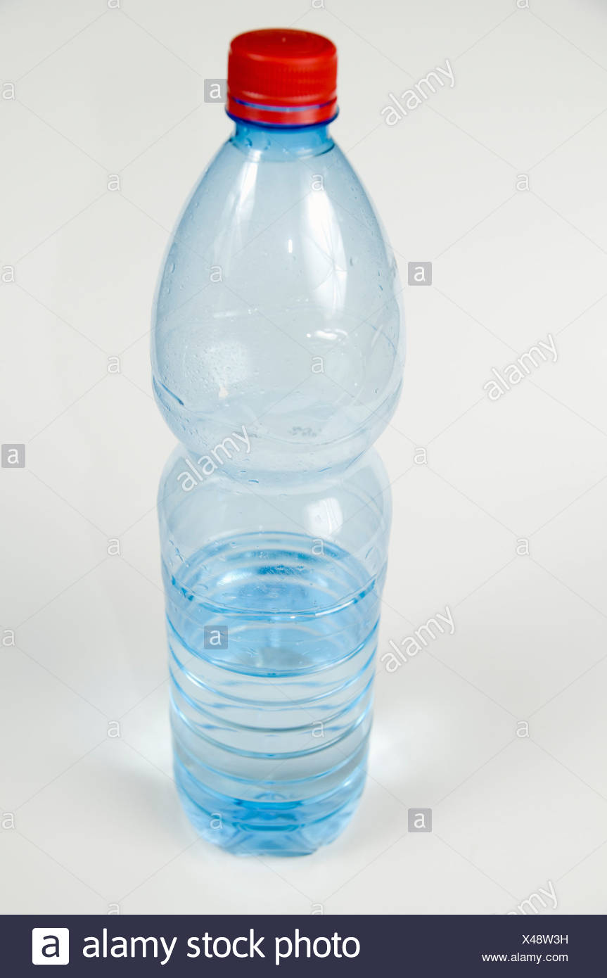 Cutout of a Plastic Bottle of Mineral Water on white background - Stock Image