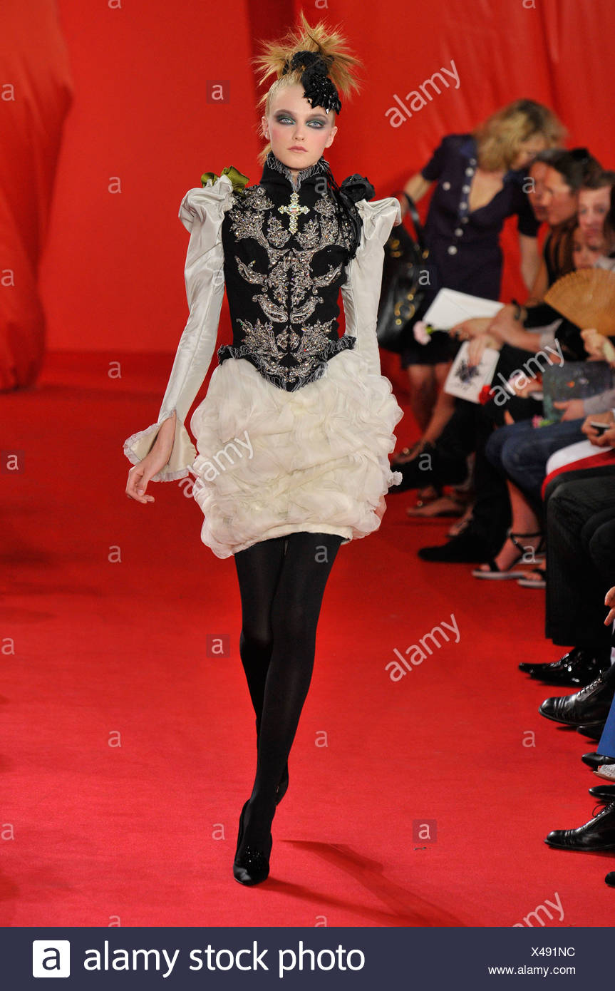 Christian Lacroix Paris Haute Couture Autumn Winter  Model wearing a cream ruffled minidress, long puffed sleeves, and a black - Stock Image