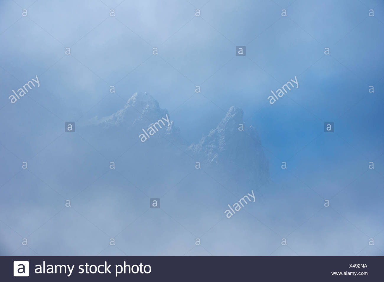 Viererspitze over Mittenwald in the western Karwendel, shines through the clouds - Stock Image