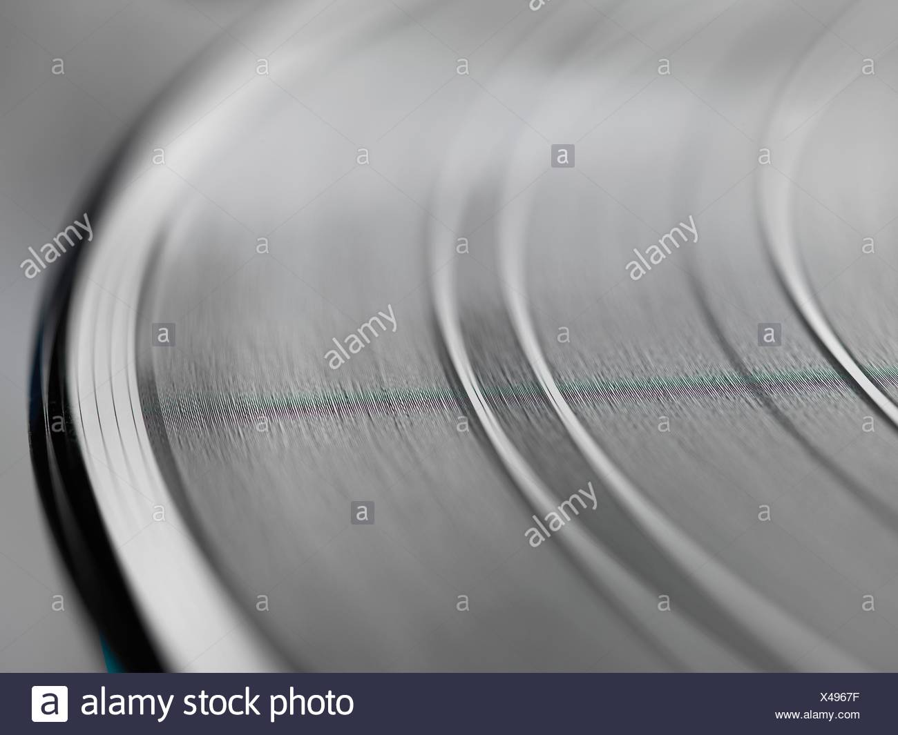 Extreme close up of grooves on a vinyl record - Stock Image