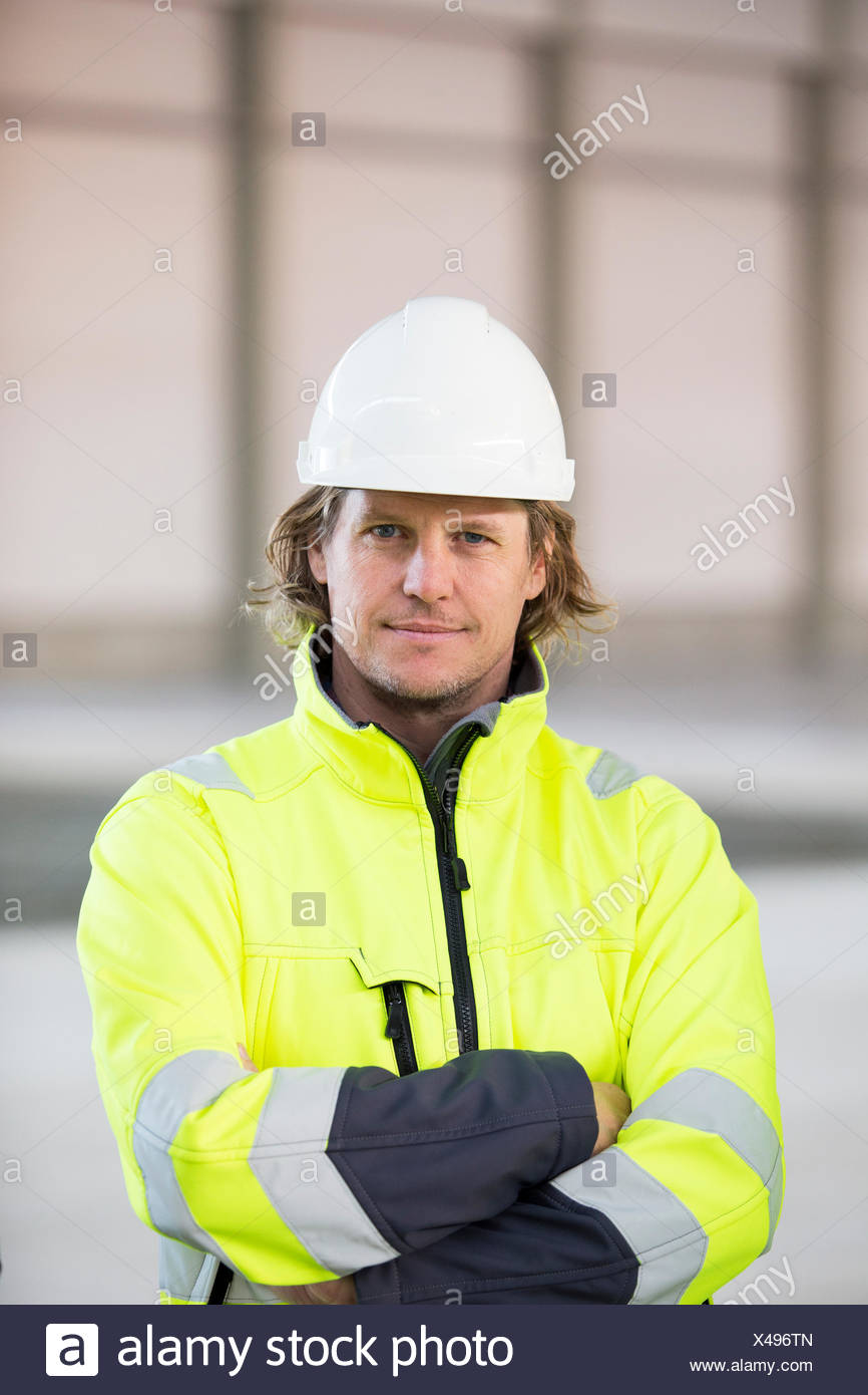 Sweden, Portrait of man wearing reflective jacket and helmet - Stock Image