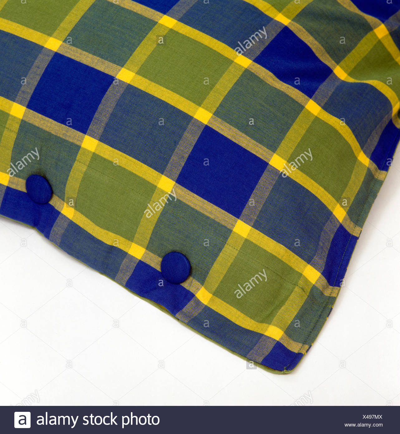 Close-up of a buttoned blue+green cushion - Stock Image