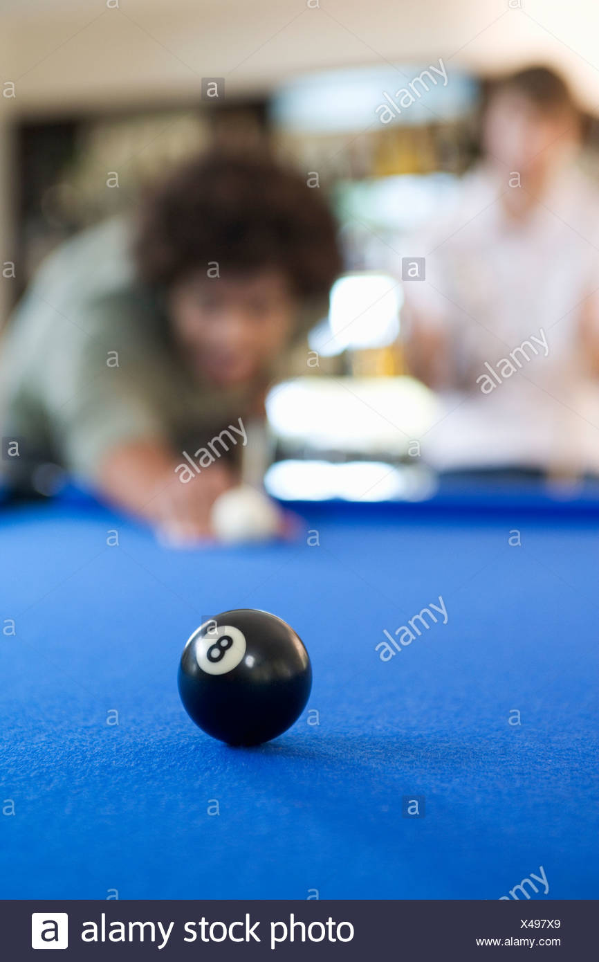 Two young men playing pool - Stock Image