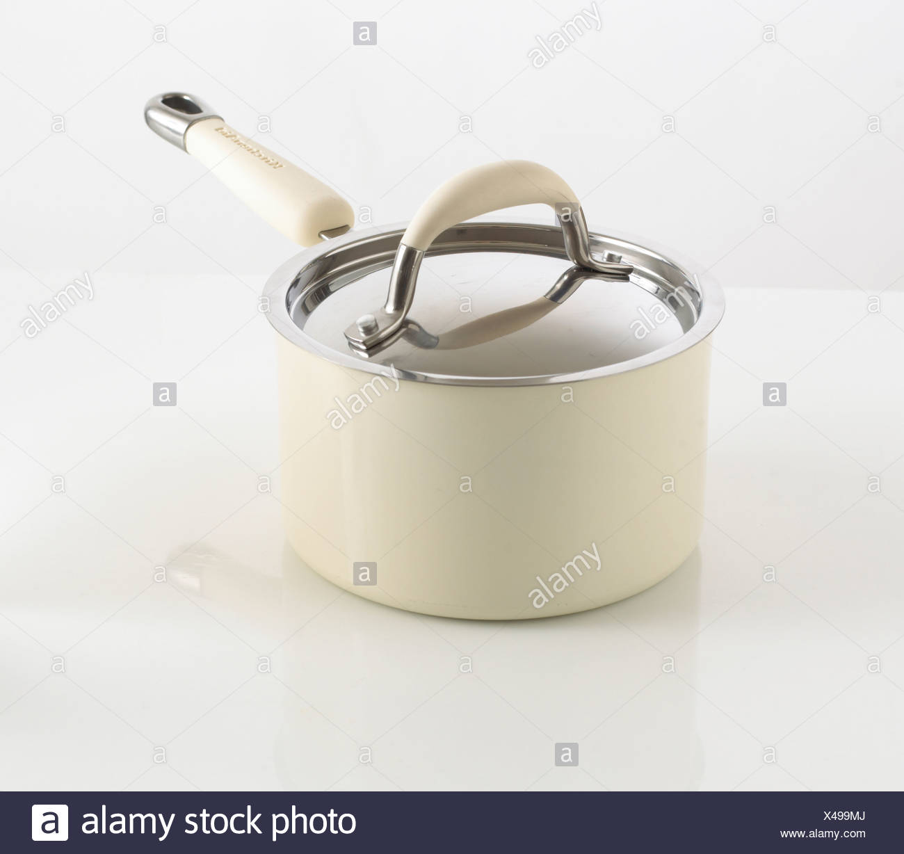 Cream saucepan and lid - Stock Image