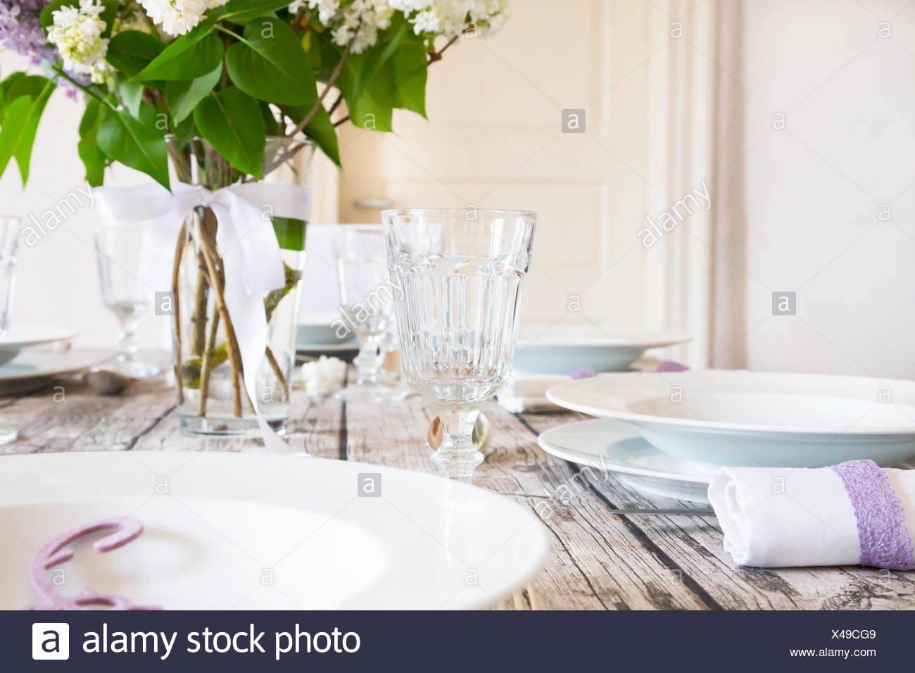 Laid table with lilac - Stock Image