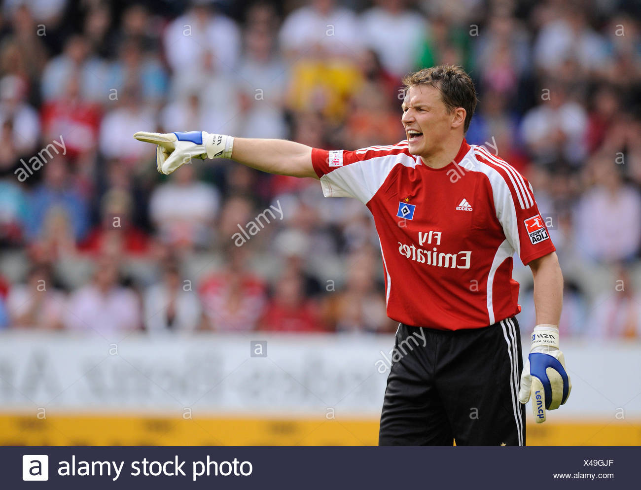 Goalkeeper Frank Rost, German footballer playing for HSV, Hamburger SV, ordering defense - Stock Image