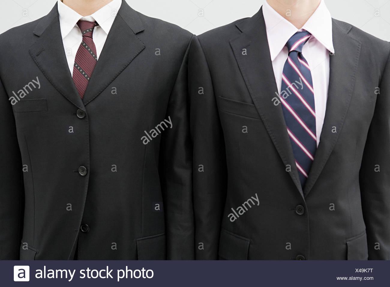 Businessmen wearing suit jackets - Stock Image