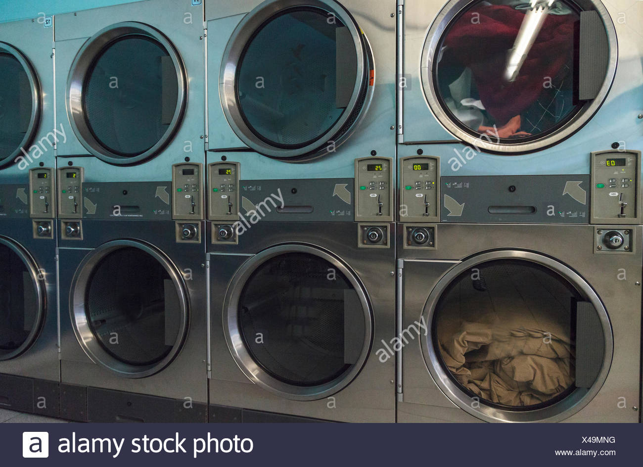 Washing clothes and drying at the Laundromat - Stock Image